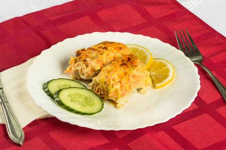 Рыба, запеченная под соусом