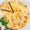 Фото к позиции меню Осетинский пирог с сыром и зеленым луком (1200 г)