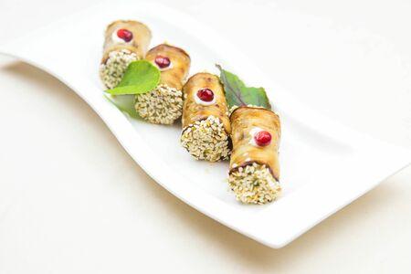 Рулетики из баклажан с орехами
