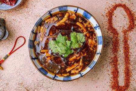 Суп кисло-острый с курицей и креветками