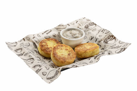 Картофельники с грибным соусом