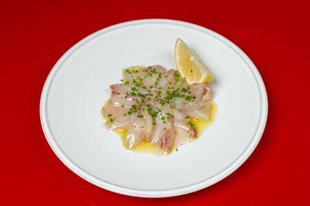 Сибас, лимон, оливковое масло