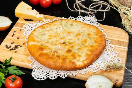 Осетинский пирог с сыром, зеленью и картошкой