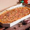 Фото к позиции меню Пицца Ветчина-грибы полуметровая