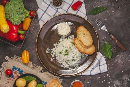 Котлеты из судака и трески жареные, подаются с рисом Басмати