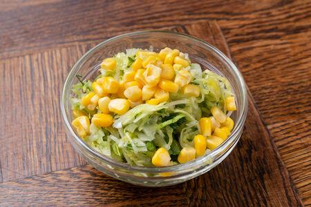 Салат из свежей капусты с огурцом и  кукурузой