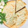 Фото к позиции меню Осетинский пирог с картофелем и шпинатом (1200 г)