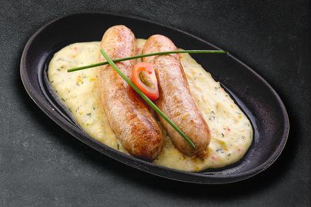 Фирменные колбаски из  свининой с ароматным беконом и фисташками
