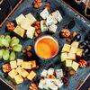 Фото к позиции меню Ассорти благородных сыров