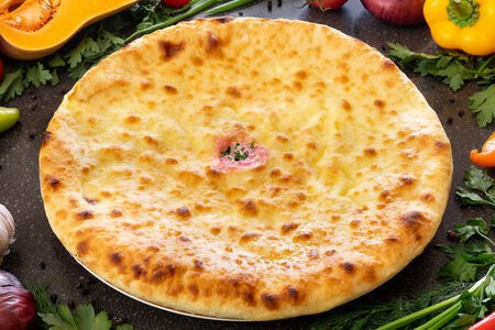 Осетинский пирог с листьями свеклы, зеленью и осетинским сыром