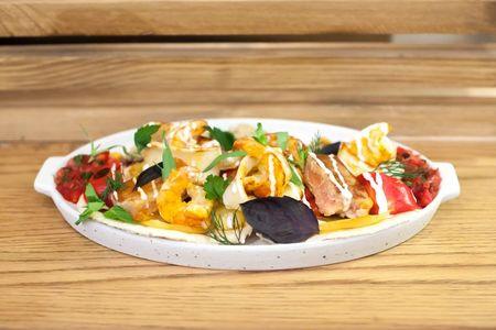 Шашлык ассорти из морепродуктов с печеными овощами