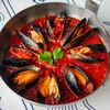 Фото к позиции меню Мидии в томатном соусе