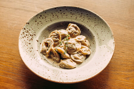 Итальянские пельмени со сливочным соусом дорблю