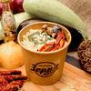 Фото к позиции меню Каша пшённая с вялеными томатами и баклажанами