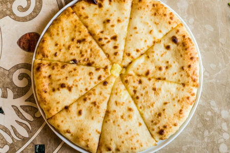 Осетинский пирог с сыром и луком Хахуыджын
