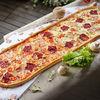 Фото к позиции меню Метровая пицца Мясное ассорти