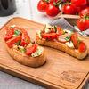 Фото к позиции меню Брускетта с моцареллой и томатами