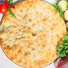 Фото к позиции меню Осетинский пирог с говядиной и картошкой (1200 г)