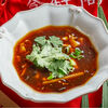 Фото к позиции меню Кисло-острый суп с креветками и курицей