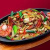 Фото к позиции меню Жареная лапша Удон с морепродуктами