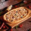 Фото к позиции меню Пицца Четыре океана полуметровая