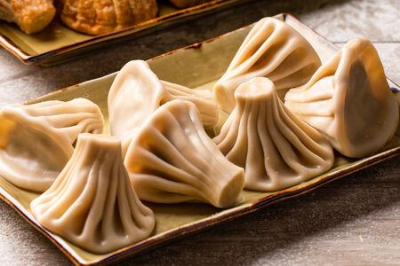 Хинкали с сыром Сулугуни и кинзой