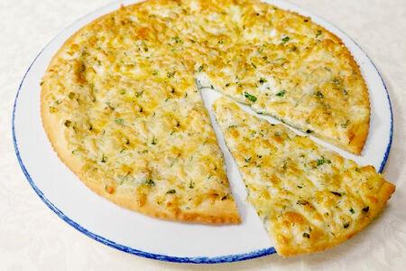 Осетинский пирог с сыром сулугуни и зеленью