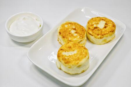 Сырники со сметаной