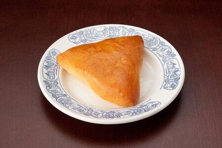 Пирожок с мясом и рисом