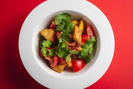 Салат из теплых баклажан с помидорами
