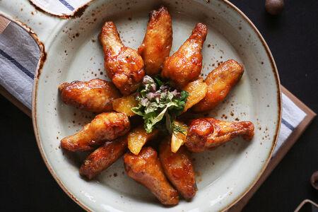 Куриные крылья в апельсиновом соусе чили