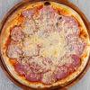 Фото к позиции меню Пицца Мясное трио