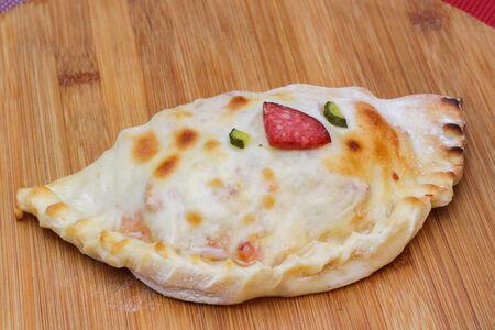 Пицца кальцоне Максима