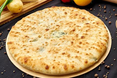Осетинский пирог с сыром, картофелем и зеленым луком