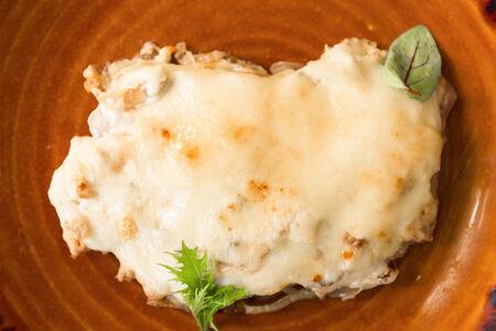 Свинина, запеченная с сыром и грибами