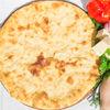 Фото к позиции меню Осетинский пирог с сыром и курицей (1200 г)