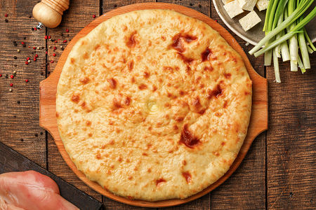 Осетинский пирог с курицей, сыром и зеленым луком