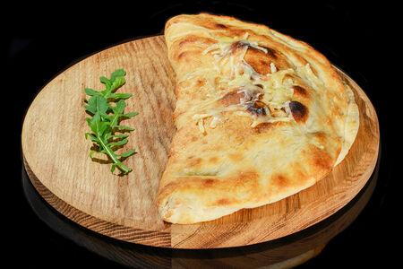 Пицца Кальцоне с ветчиной и грибами