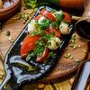 Фото к позиции меню Мини-моцарелла с томатами и базиликом