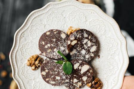 Колбаса шоколадная с орехами