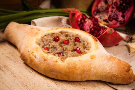 Хачапури по-аджарски с куриным филе в аджике и сыром