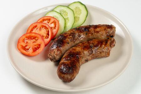Колбаски мясные