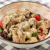 Фото к позиции меню Салат с куриной печенью и карамелизированной грушей