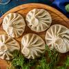 Фото к позиции меню Хинкали с сыром сулугуни и зеленью