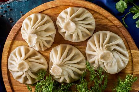 Хинкали с сыром сулугуни и зеленью