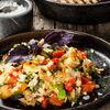 Фото к позиции меню Холодный салат из запеченных овощей с кинзой, чесноком и базиликом