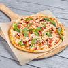 Фото к позиции меню Пицца Прошутто с вялеными томатами