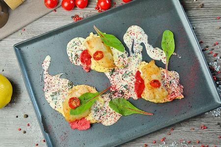 Филе палтуса на сливочном шпинате с цветной капустой