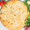 Фото к позиции меню Осетинский пирог с говядиной и грибами (1200 г)