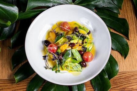 Сибас с овощами в цитрусовом соусе и таджаскими оливками